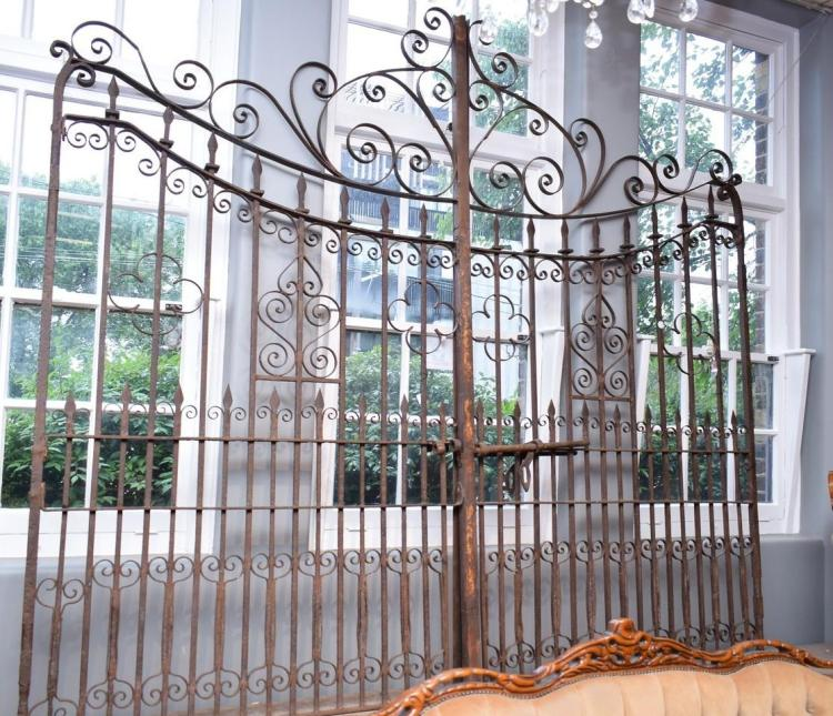 A PAIR OF IMPRESSIVE SPANISH PROVINCIAL STYLE WROUGHT IRON GATES (300cm w x 250cm h)