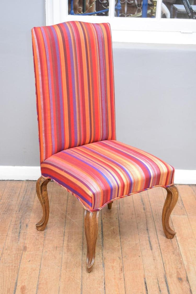 A FRENCH PROVINCIAL STYLE HIGHBACK CHAIR IN MOROCCAN FABRIC