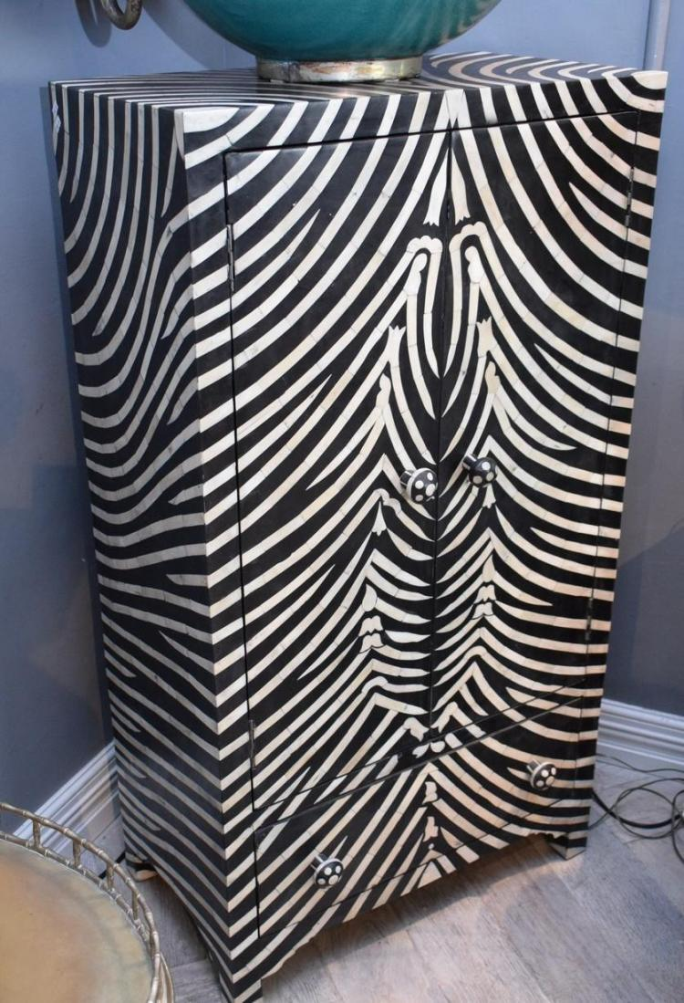 A ZEBRA PATTERNED CUPBOARD (72cm w x 41cm d 132cm h)
