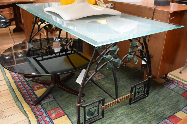 A PROVINCIAL STYLE GLASS TOP DINING TABLE - damage to one corner