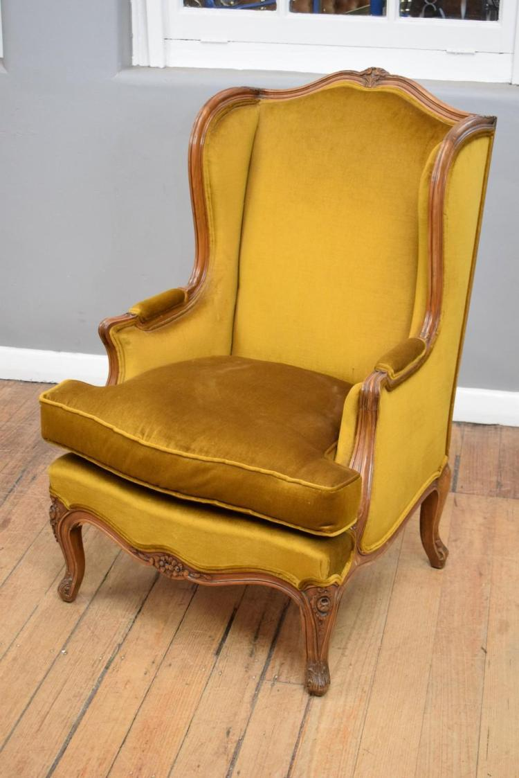 A Louis Xv Style Velvet Upholstered Wingback Armchair With D