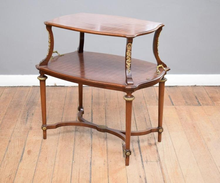 A LOUIS XVI STYLE GILT MOUNTED TWO TIERED ETAGERE