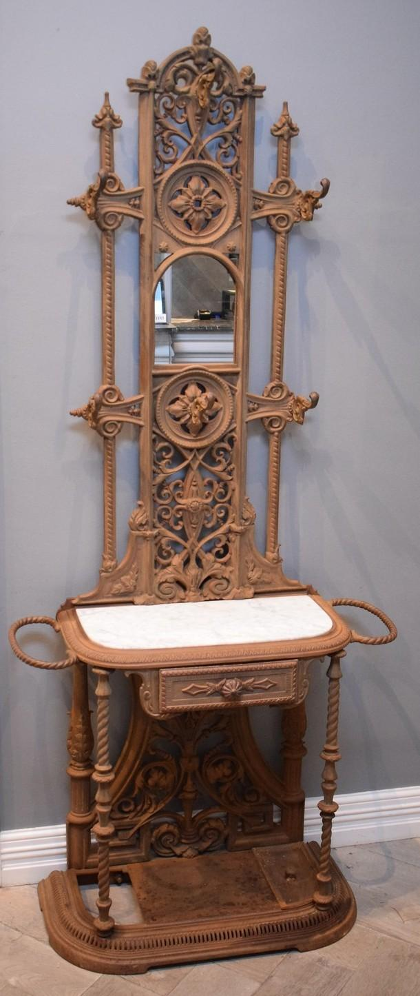 A VICTORIAN CAST IRON MARBLE INSET HALL STAND (85cm w x 38cm d x 196cm h)
