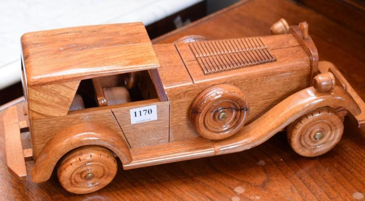 A TIMBER MODEL OF A 1920s-30s CAR