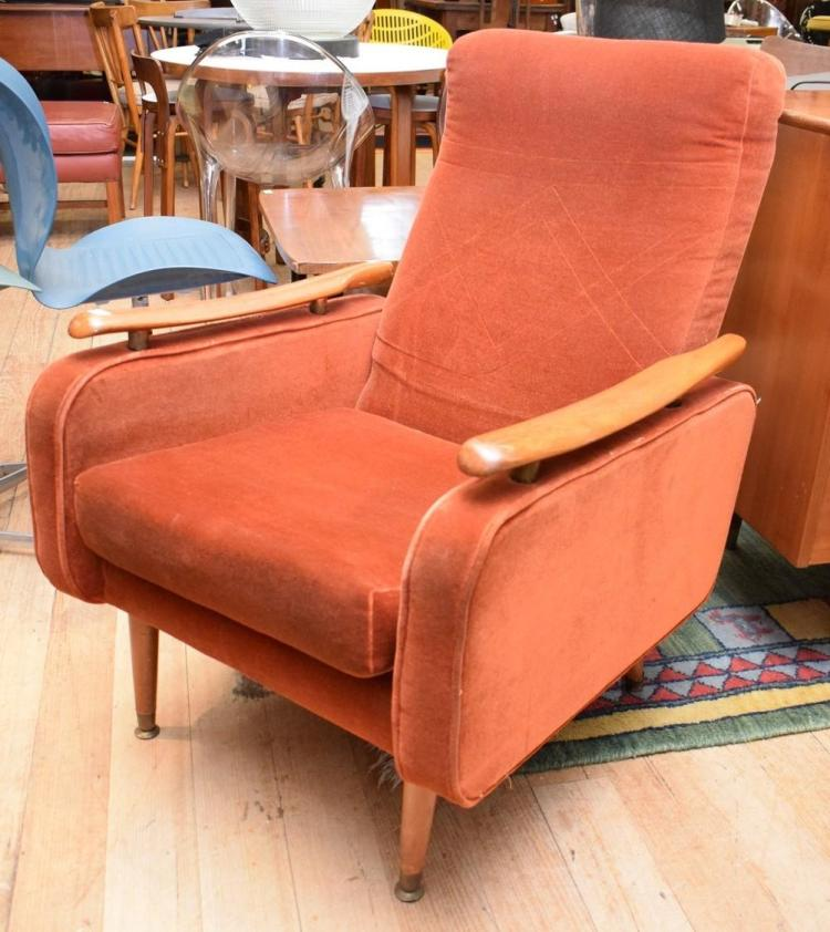 A MID-CENTURY ORIGINAL UPHOLSTERED ARMCHAIR