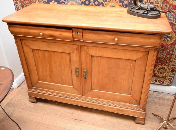 A 19TH CENTURY PROVINCIAL STYLE SIDEBOARD (detached foot and loose door hinge)