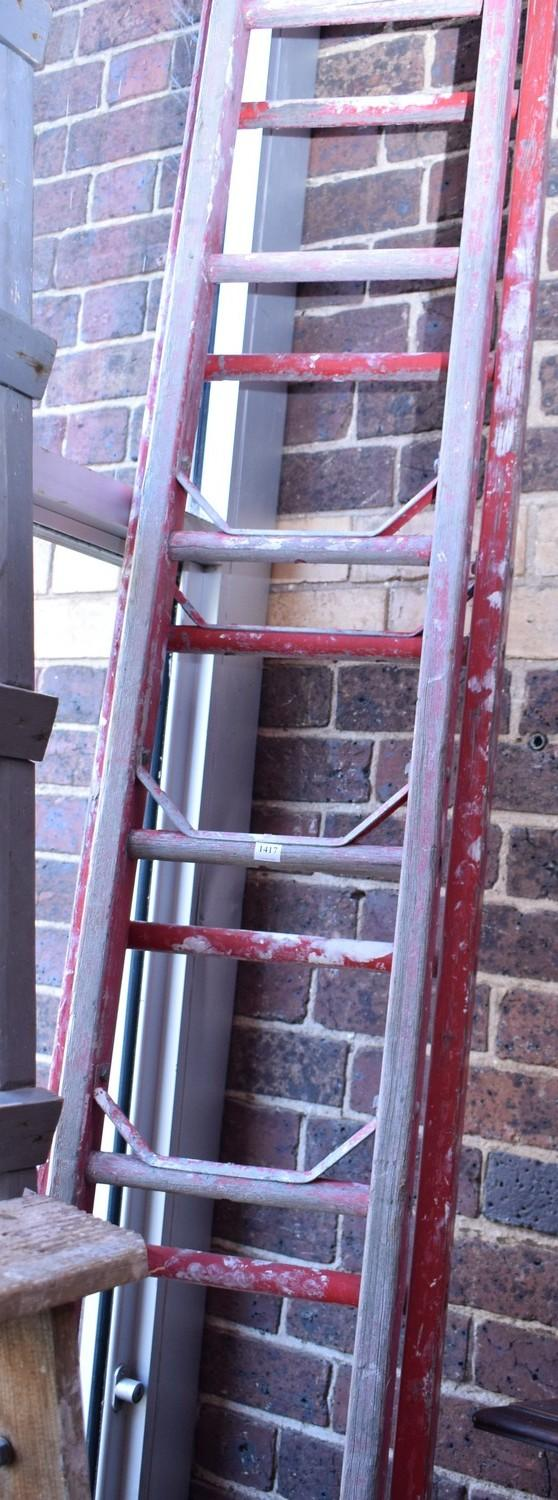 A VINTAGE TIMBER EXTENSION LADDER