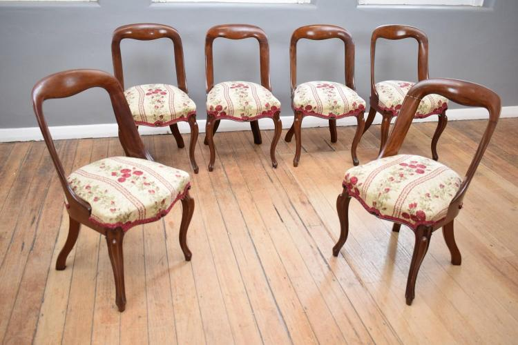 A SET OF SIX VICTORIAN MAHOGANY SPOON BACK DINING CHAIRS
