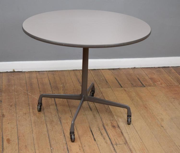 A HERMAN MILLER EAMES CIRCULAR TABLE