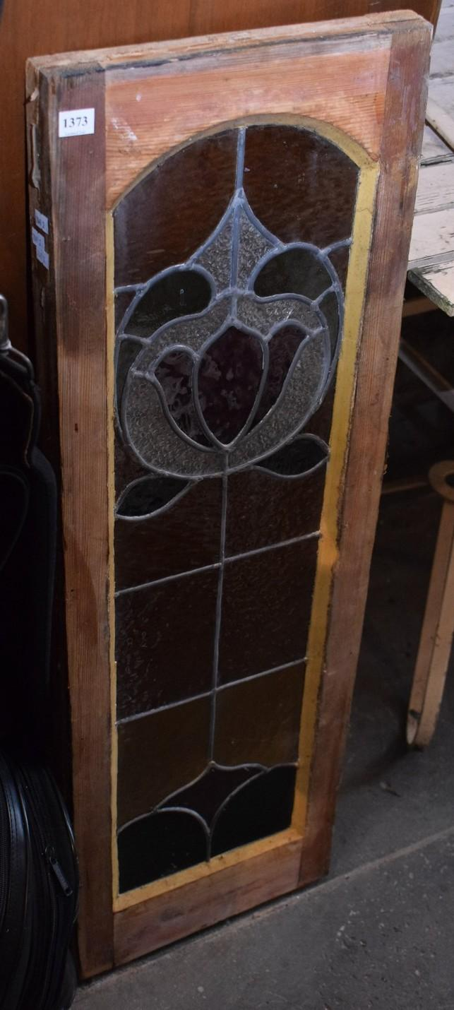 A STAINED GLASS TIMBER PANEL