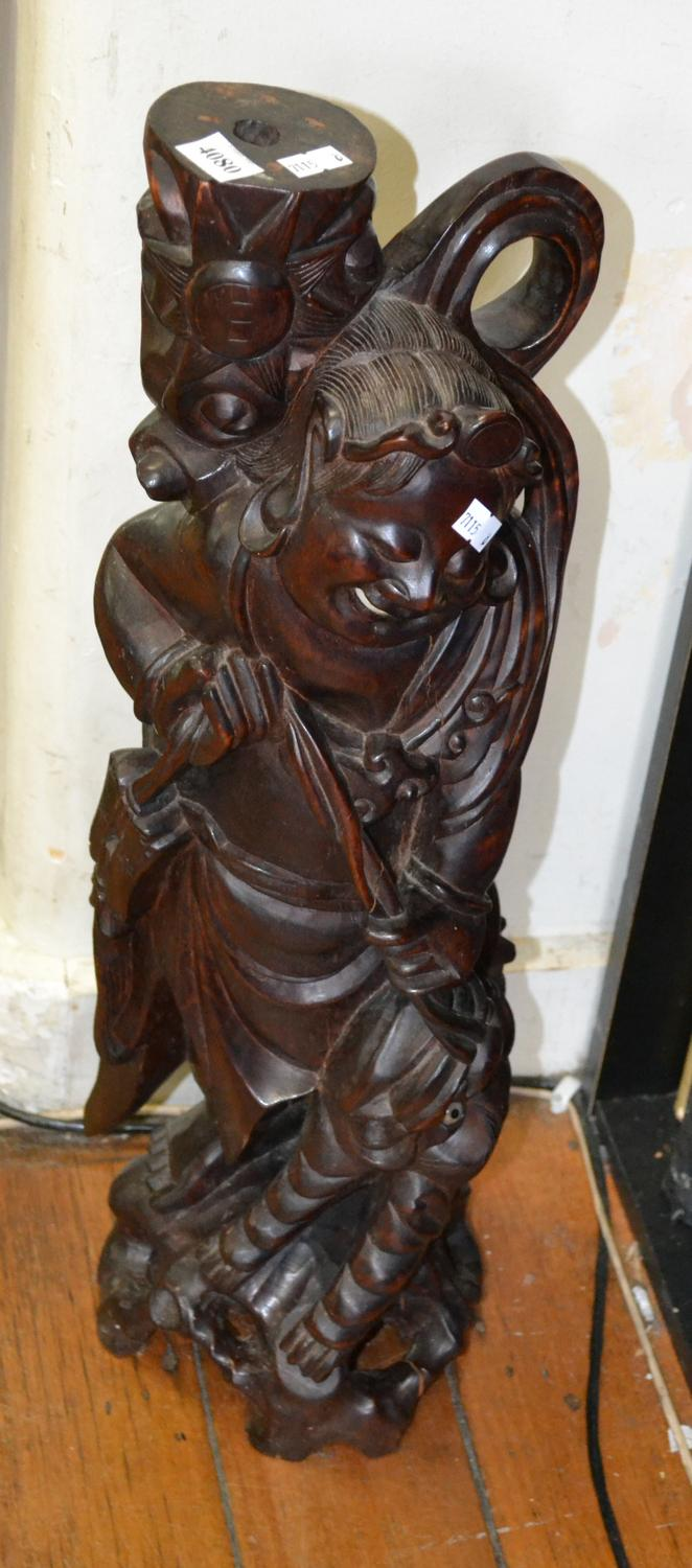 A WOODEN CARVED FIGURE OF MAN WITH LION FASHIONED IN TO A LAMP BASE