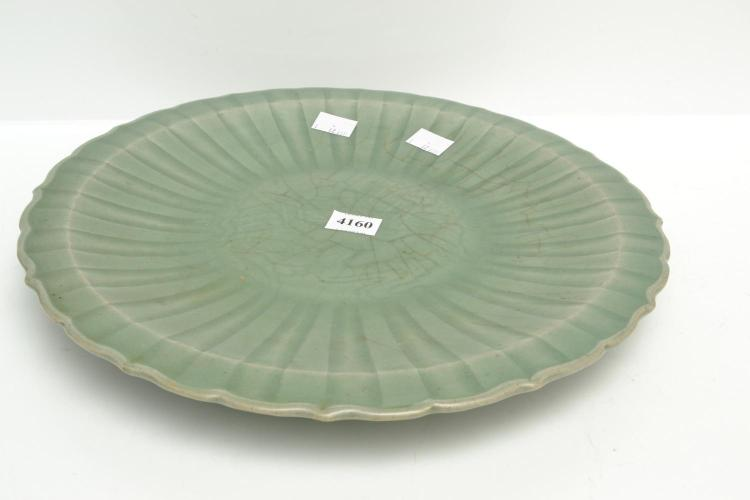 A CHINESE CELEDON PLATE WITH CENTRAL MOTIFS