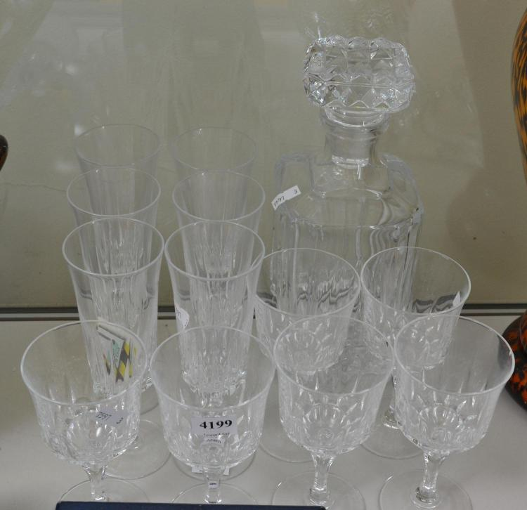 A PRESSED GLASS DECANTER AND CHAMPAGNE AND WINE STEMWARE