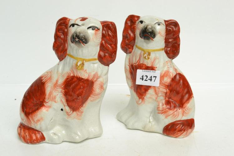 A PAIR OF STAFFORDSHIRE SPANIELS