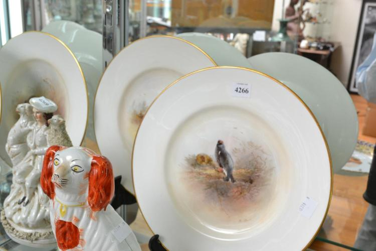 A SET OF FOUR ROYAL WORCESTER PLATES, BY JAMES STINTON