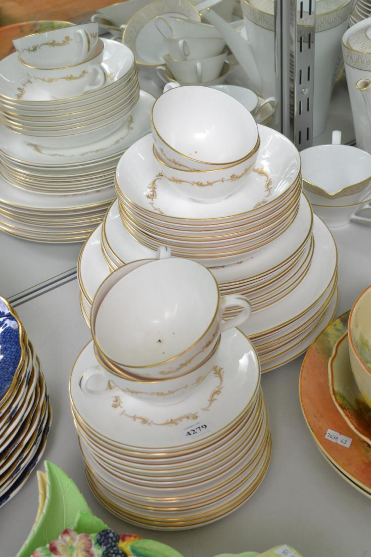 A ROYAL DOULTON 'FRENCH PROVINCIAL' DINNER SETTING