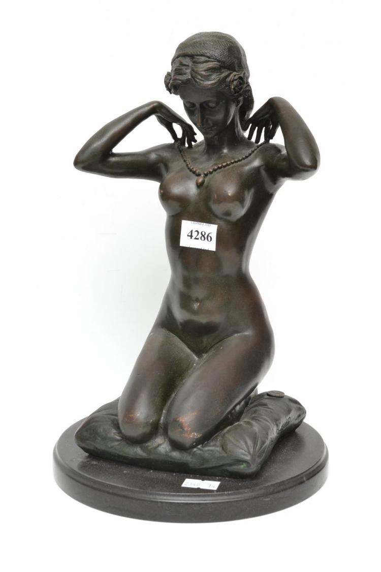 A BRONZE SEATED NUDE ON CUSHION, SIGNED PAUL PONSARD