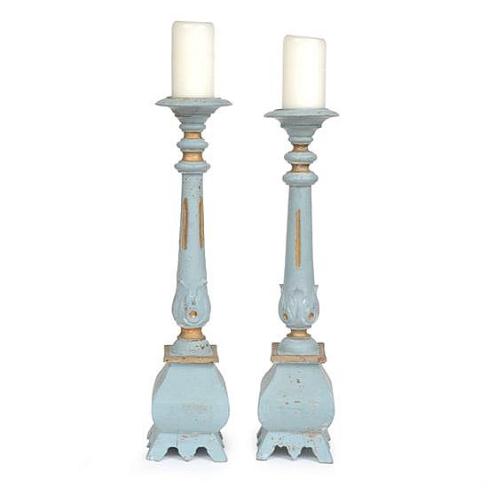 A PAIR OF CLASSICAL STYLE PAINTED AND GILT TORCHERESEACH 62CM HIGH