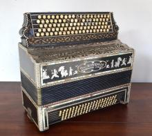 AN ITALIAN PIANO ACCORDIAN  WITH DECORATIVE MOTHER OF PEARL INLAY