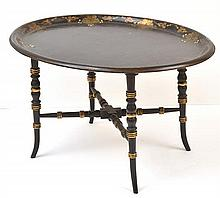 A VICTORIAN PAPIER MACHE TRAY, ATTACHED TO A LATER EBONISED STAND