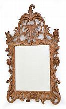 AN 18TH CENTURY CARVED PINE FRAMED WALL MIRROR