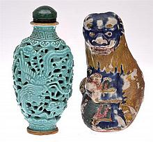 A PIERCED PORCELAIN SNUFF BOTTLE TOGETHER WITH A PORCELAIN SNUFF BOTTLE IN THE FORM OF A BUDDHIST LION