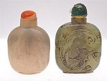 TWO GREEN STONE SNUFF BOTTLES WITH CONTRAST STOPPERS