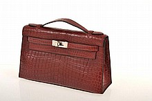 A Crocodile Kelly Pochette bag by Hermés