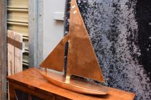 A COPPER SAILING BOAT