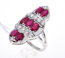 A RUBY AND DIAMOND CLUSTER RING SET IN 18CT WHITE GOLD
