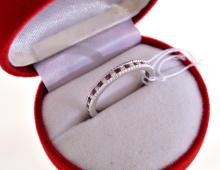 A RUBY AND DIAMOND ETERNITY RING IN 14CT WHITE GOLD