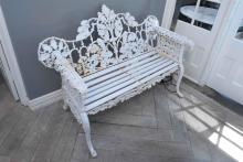 A WHITE PAINTED CAST IRON BENCH (PLEASE NOTE: IF PURCHASED, THIS ITEM MUST BE PROFESSIONALLY REMOVED BY SPECIALIST CARRIERS AT THE C...