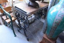 A VICTORIAN CAST IRON SEWING MACHINE BASE WITH TIMBER TOP
