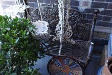 A FRENCH STYLE CAST IRON BENCH