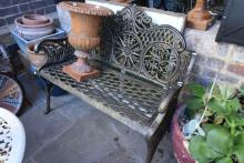 A DECORATIVE CAST IRON BENCH SEAT