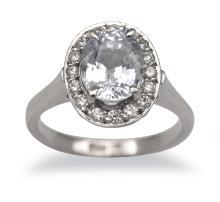A CEYLON SAPPHIRE AND DIAMOND CLUSTER RING