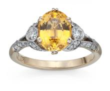A GOLDEN SAPPHIRE AND DIAMOND RING