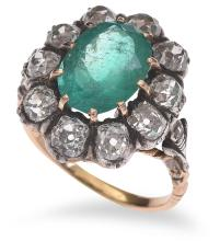 A VICTORIAN EMERALD AND DIAMOND CLUSTER RING