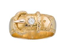 A VICTORIAN GOLD AND DIAMOND BUCKLE RING