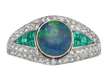 AN OPAL, DIAMOND AND EMERALD RING