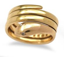 A VICTORIAN GOLD TRIPLE COIL SNAKE RING