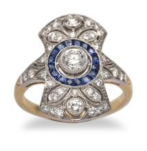 A DIAMOND AND SAPPHIRE PLAQUE RING