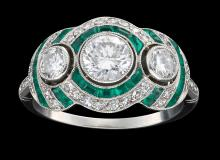 A DIAMOND AND EMERALD PLAQUE RING