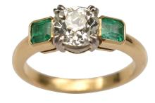 A THREE STONE DIAMOND AND EMERALD RING