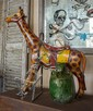 A CHILD'S AMUSEMENT RIDE IN THE SHAPE OF A GIRAFFE