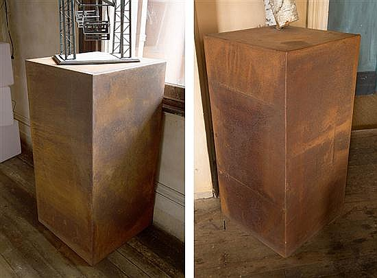 A MONUMENTAL PAIR OF CORTEN STEEL PLINTHS TOGETHER WITH A SMALL CYLINDRICAL PLINTH