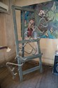 A LARGE FLOOR-STANDING PAINTED EASEL