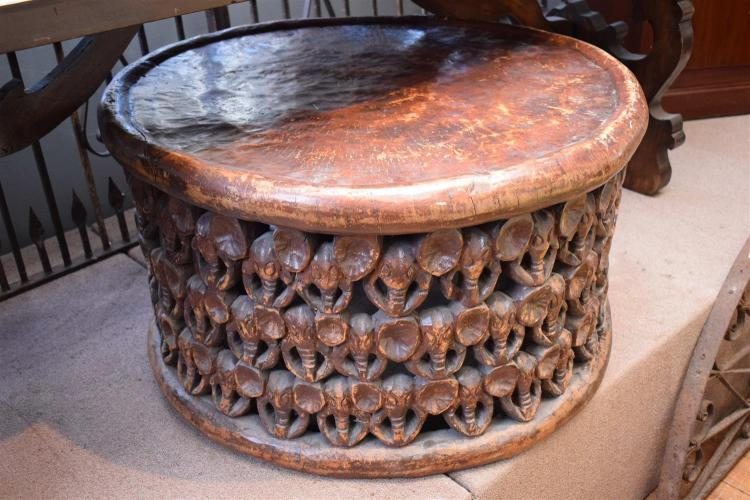 An african carved circular coffee table African coffee tables