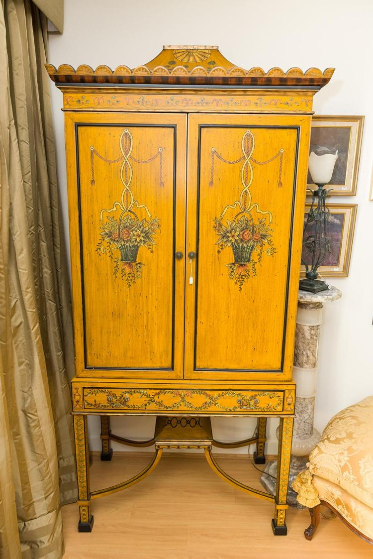 A french provincial style cabinet on stand approx 220cm high for French house of high fashion