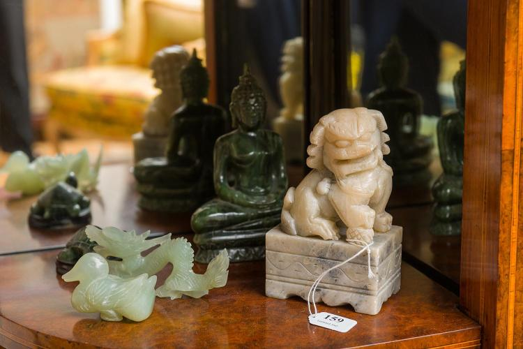 A collection of five chinese stone carvings including fo dog